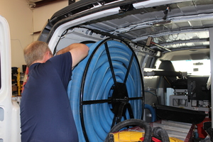 Water Damage Dam Neck Technician Prepping Suction Hoses