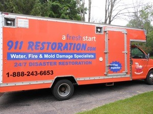 Water Damage Surry Truck Parked At Residential Job Location