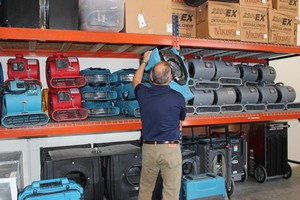 Water Damage Cape Charles Restoration Technician Prepping Air Movers