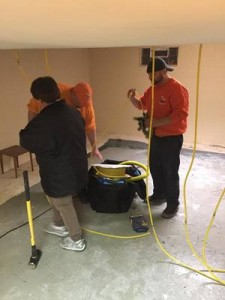 Water Damage Cape Charles crew Cleaning Living Room